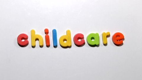 Stop motion animation of fridge magnets moving to spell the word childcare