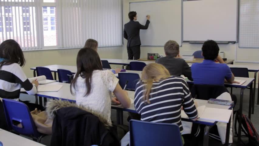 Teacher In Wheelchair, Teaching A A Class Of High School -5256