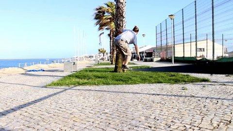 Man balancing and jumping on a slackline