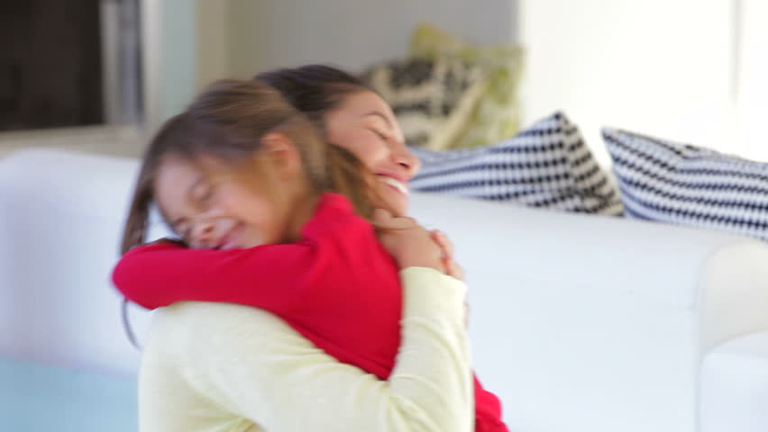 Daughter rushes into mother's arms at home and gives her a big hug. Shot on Canon 5d Mk2 with a frame rate of 30fps | Shutterstock HD Video #3795266