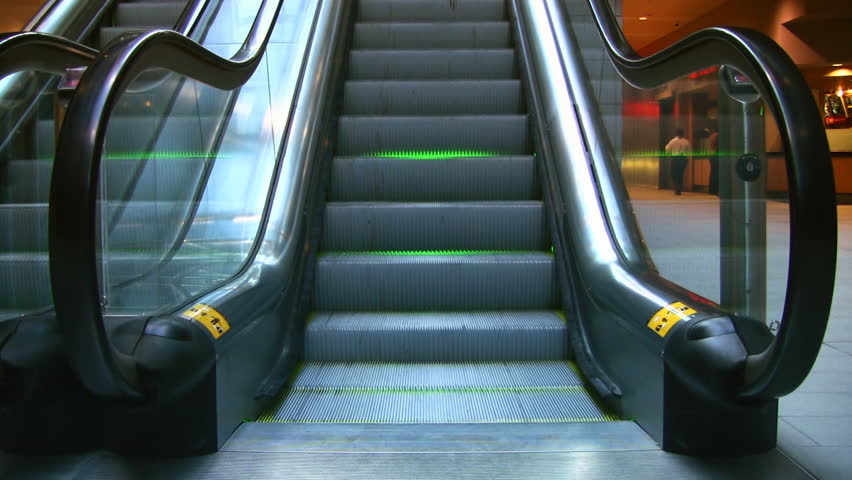 An Escalator With Neon Green Lighting Stock Footage Video 100 Royalty Free 379751 Shutterstock