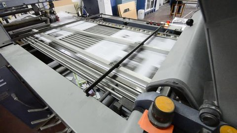 folding machine HD CRANE SHOOT folds printed offset sheet as part of newspaper brochure in print house