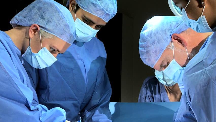 Head Shoulders Caucasian Male Surgeon Female Nurse Working In Hospital Operating Room -9543