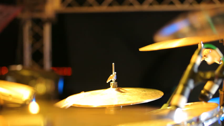 Rock band performing in a nightclub. Close-up of drummer. Rock band.