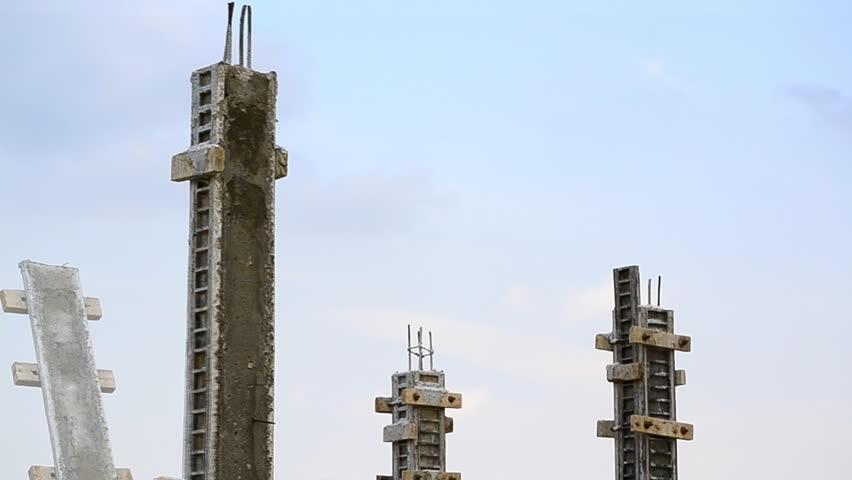 labor build pillar in construction site