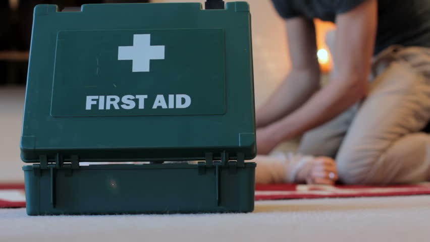 First Aid - A man runs in with a first aid kit to help a young woman who has collapsed