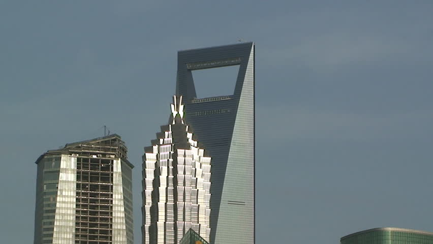Two grand skyscrapers on a clear day in Shanghai