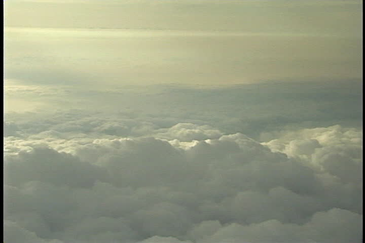 ABOVE EARTH - CIRCA MAY 1999: Cumulonimbus clouds as seen from airplane window.