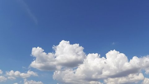 Cumulus clouds timelapse with vivid blue sky