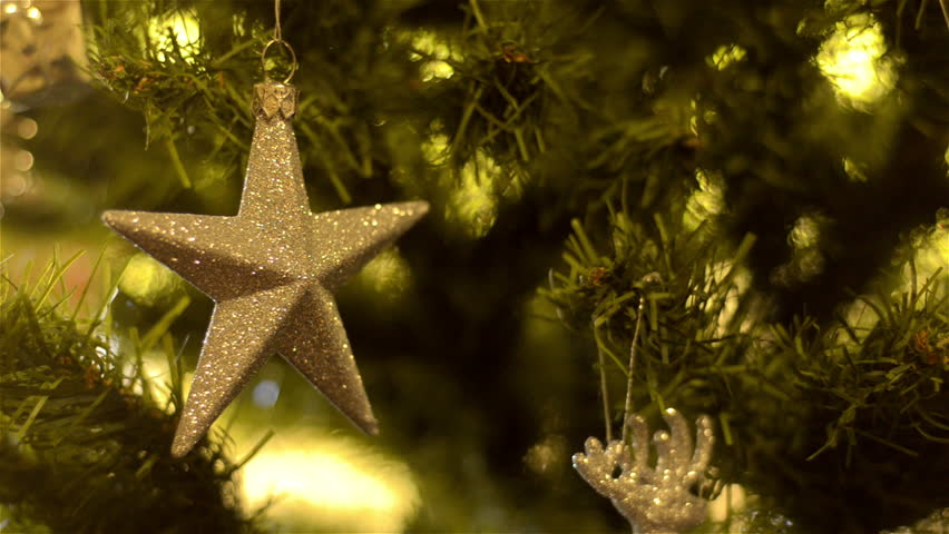 A Golden Star Ornament Decoration Hanging On A Christmas Tree  - Christmas Tree Star