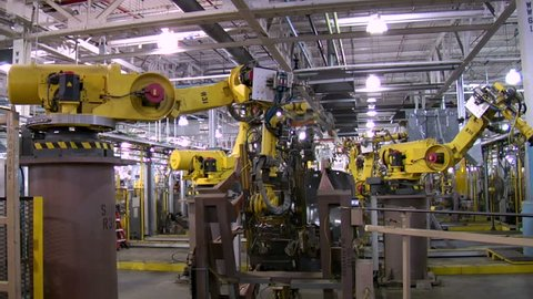 Multiple automated robotic arms pick and pluck car parts, arc welding, MIG welding and loading them onto racks to be sent to the automotive assembly line. Could be used for automotive industry, machin