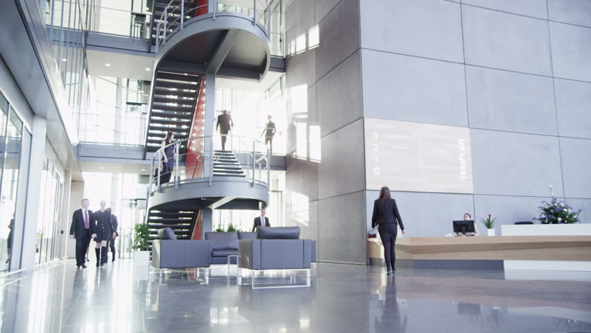 Time lapse of a large group business people moving around a spacious modern office building on a bright day. #3893471