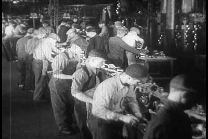 1930s - Workers at an American automobile car factory in 1930s.