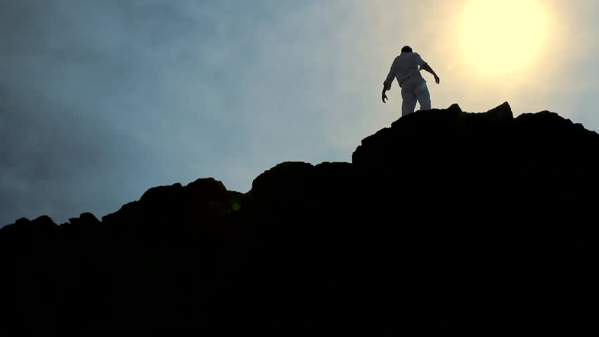 Man Climbing Rocks Lifting Hands in Worship Pose Concept Background HD | Shutterstock HD Video #3912053