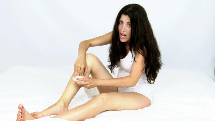 Woman screaming while shaving legs