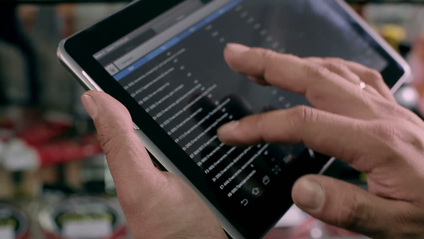 Seller forms a list items on the tablet | Shutterstock HD Video #3932291