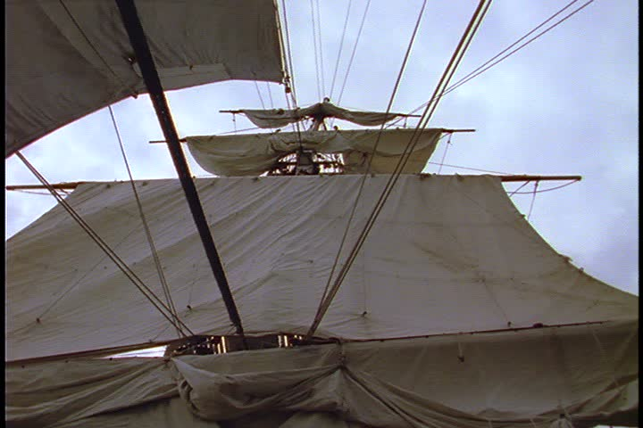 Historical reenactment of HMS Bounty ship on Rhode Island. Shots taken on the deck of the HMS Bounty; low angle shot of main mast with unfurled sails.