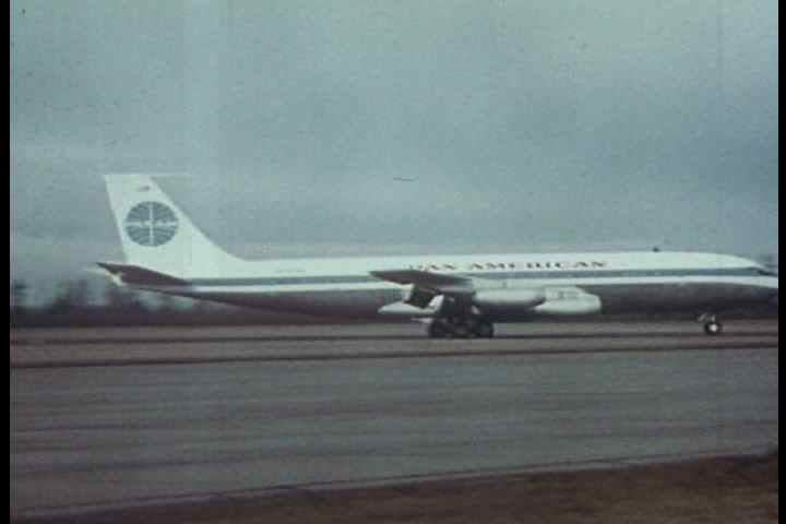 1950s - A Pan American plane lands in London and Paris and tourists explore the landmarks in 1950.