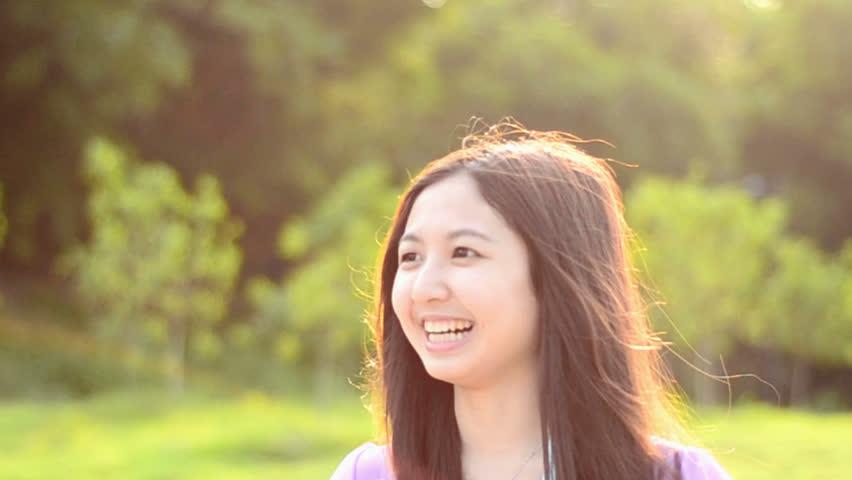 Asian girls laughing boys