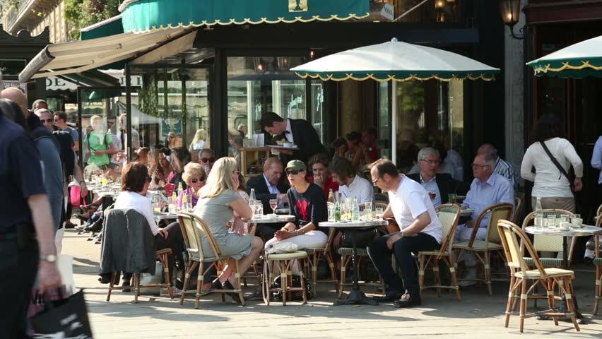 PARIS   APRIL 26: Unidentified People Sit At Paris Cafe, Deux Magots On  April