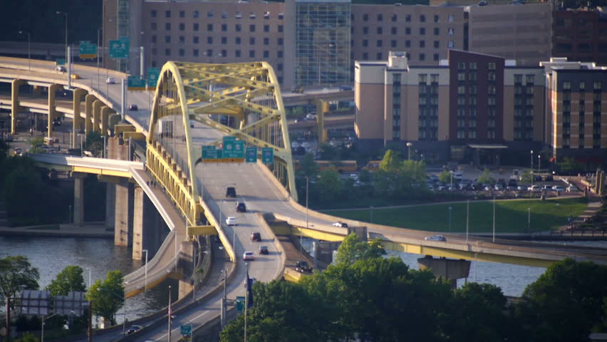 Traffic passes over the Fort Duquesne Bridge over the Allegheny River in