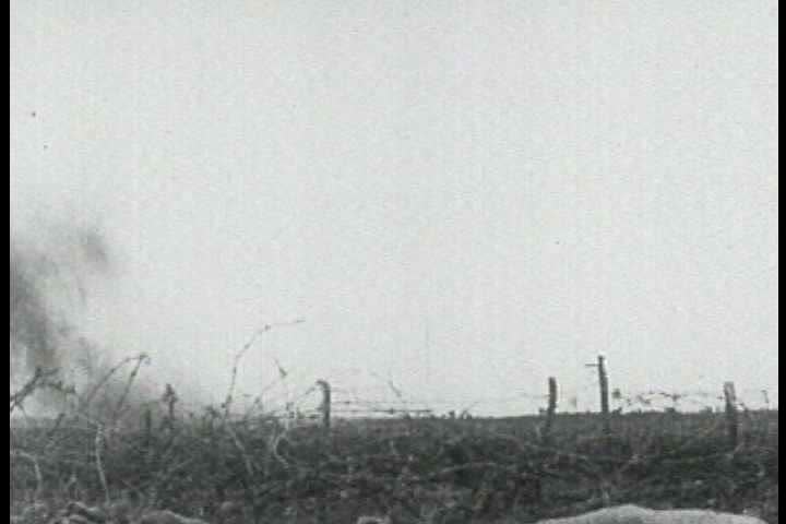 1910s - British troops fire cannons on the battlefield in World War One, 1917.