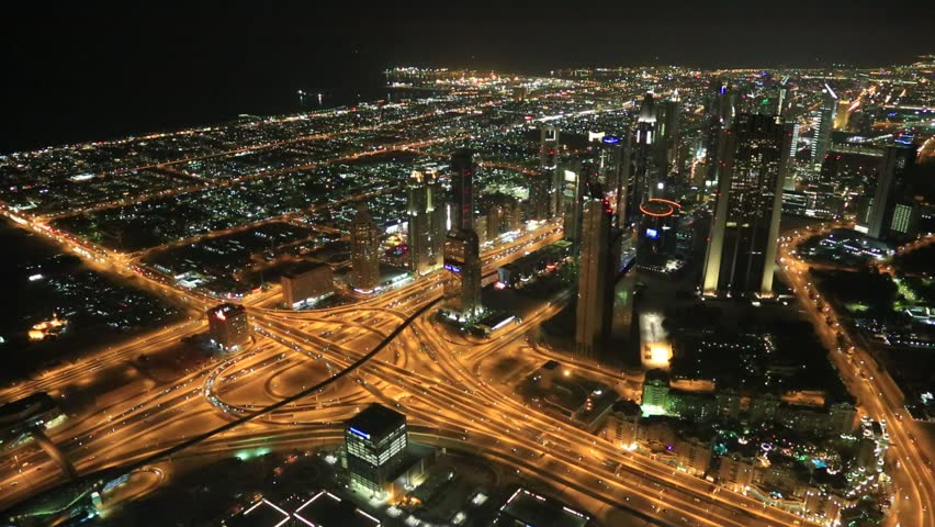DUBAI, UAE - NOVEMBER 13: Aerial view of Downtown Dubai with man made lake and skyscrapers from the tallest building in the world, Burj Khalifa, at 828m, taken on 13 November 2012 in Dubai.   Shutterstock HD Video #3997897