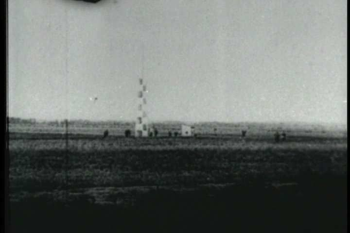 1900s - Early film footage of the Wright Brothers plane at Kitty Hawk and people who knew the Wrights are interviewed. - SD stock footage clip