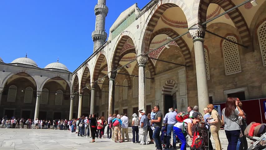 ISTANBUL - MAY 16: Crowd of tourists wait their turn to visit Blue Mosque on May 16, 2013 in Istanbul. Courtyard of Blue Mosque
