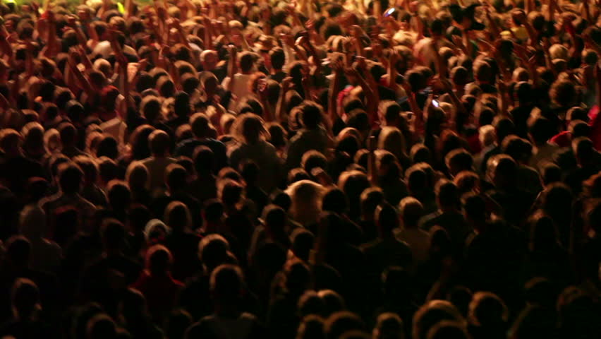 Shot of some cheering fans at a life concert, some visible noise due high ISO, soft focus | Shutterstock HD Video #4010470