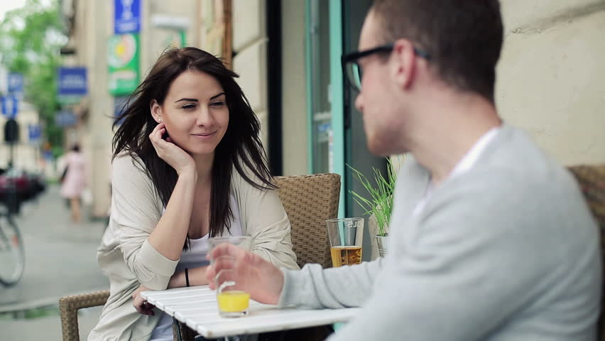 Young happy couple chatting in cafe, steadicam shot  | Shutterstock HD Video #4012591
