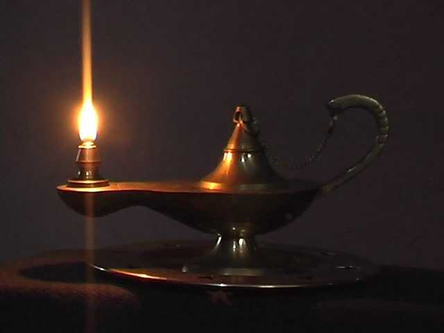 Old Antique Magic Lamp Burning On The Table   SD Stock Video Clip
