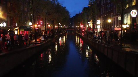 AMSTERDAM - MAY 11: Night view of the famous Red Light district in Amsterdam, Netherlands on May 11, 2013