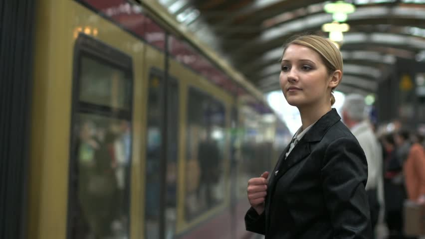 blond women in train station