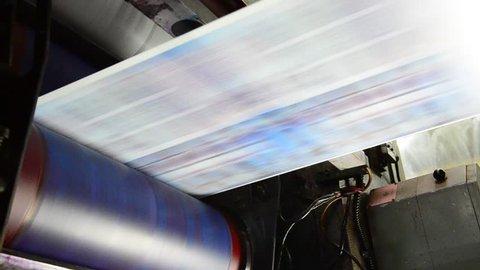 Web set offset print shop newspapers Printing (Loop), Newspapers coming off the rotation printing press industrial machine. Seamless looping video.