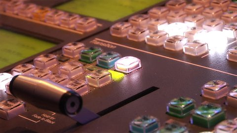 This high definition footage is of a television video switch to button controls