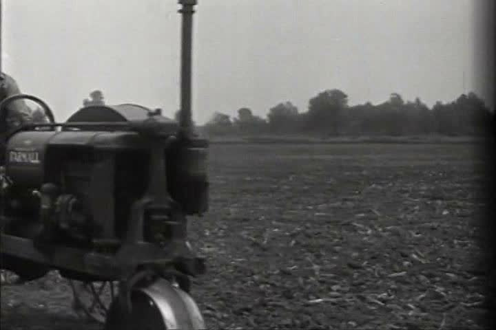1920s - Tractors and plows of all kinds are used on the farm in 1926.