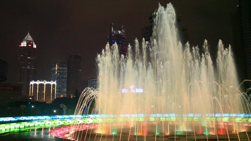 Fountain glows lights in night
