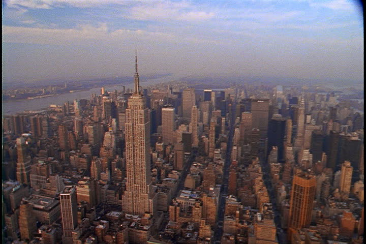 Aerial shot over Manhattan slowly circling the Empire State Building in New York City, USA. | Shutterstock HD Video #4059013