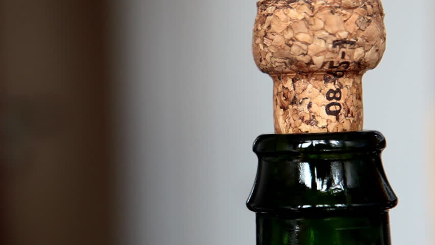 Cork flying off a bottle of sparkling french cider