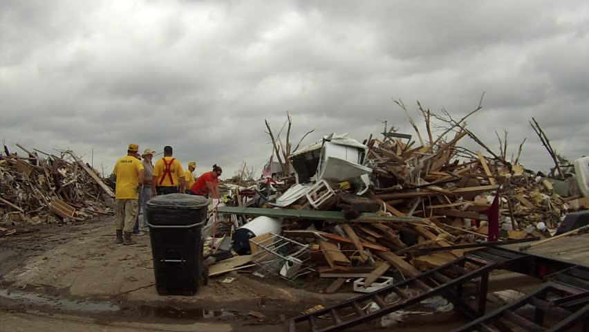 MOORE, OK - MAY 20, 2013:This was a neighborhood in Moore, Oklahoma after the EF5 tornado hit on May 20, 2013.  Houses are turned to ruble.  Destroyed cars litter the street and yards.  Trees are stripped of leaves and bark.