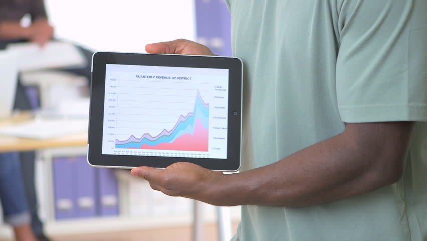 Black businessman holding tablet with sales data | Shutterstock HD Video #4068880