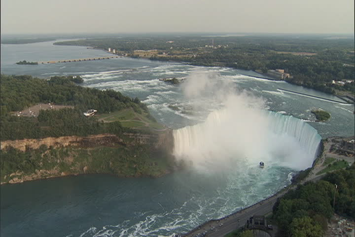 High angle view of river and Horseshoe Falls with white mist rising from the falls at Niagara Falls, Ontario, Canada.