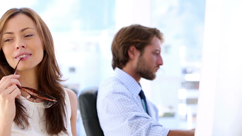 Creative woman thinking with her coworker working in the bottom
