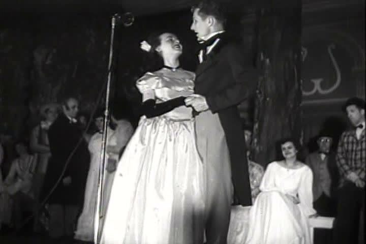 1940s - Home movies of a bride and groom kissing and accordion trio.