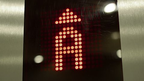 Red Elevator digits.