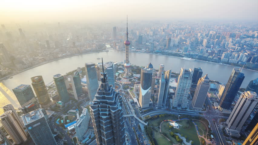 Shanghai from day to night, time lapse.  Aerial...