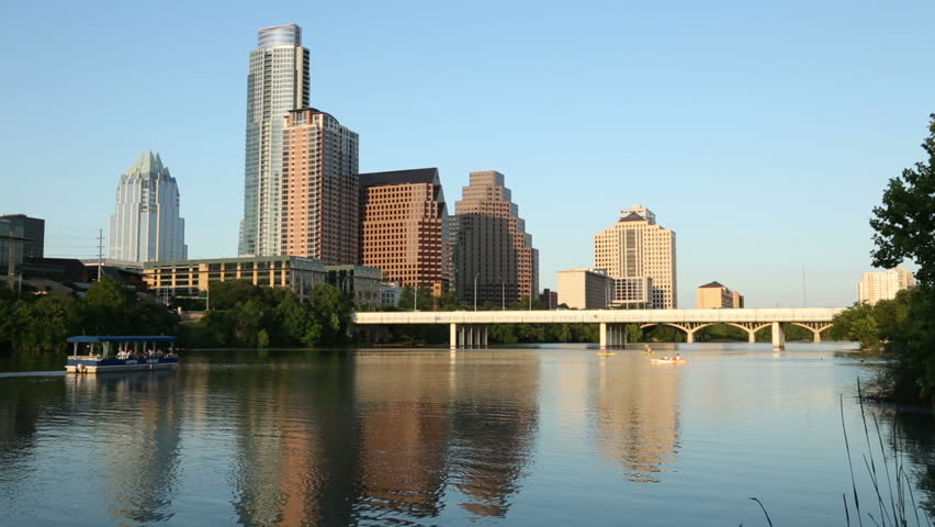 Late light on a calm Lady Bird Lake with Austin skyline in background, Texas, USA