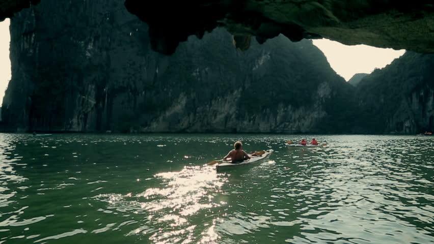 Vietnam, Hanoi - June 02: Man on the boat sails under the rocks on June 02, 2013 in Vietnam,Hanoi.