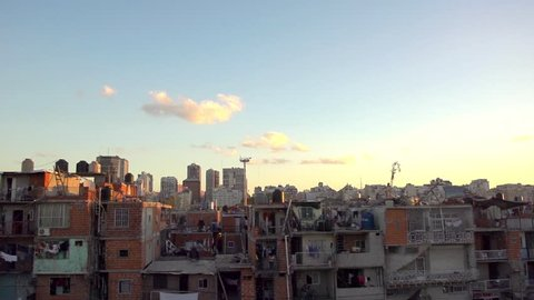 Buenos Aires pov travel past impoverished residential neighborhood at sunset.